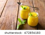 two glass jars with delicious... | Shutterstock . vector #672856183