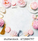 pink cupcakes with roses and... | Shutterstock . vector #672884797