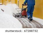 Man working with a snow blowing machine - stock photo