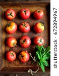 Red Tomatoes With Basil Leaves...