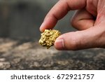 Small photo of The pure gold ore found in the mine is in the hands of men