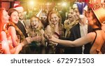 young friends dancing on the... | Shutterstock . vector #672971503