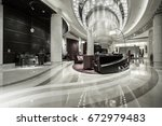 hotel lobby interior with... | Shutterstock . vector #672979483