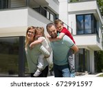 portrait of young happy family...   Shutterstock . vector #672991597