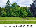 rustic wooden slatted bench in...   Shutterstock . vector #673017217