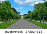 tree lined avenue in a park... | Shutterstock . vector #673024813