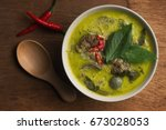 thai food beef green curry on... | Shutterstock . vector #673028053