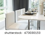 white chair and luxury plate... | Shutterstock . vector #673030153