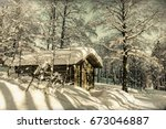Wooden Cottage In Winter Fores...