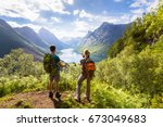two hikers at viewpoint in the... | Shutterstock . vector #673049683