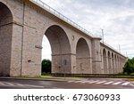 stone railway bridge in... | Shutterstock . vector #673060933
