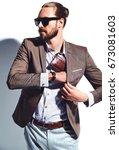 portrait of handsome fashion... | Shutterstock . vector #673081603