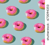pink glazed donut pattern on... | Shutterstock . vector #673094353