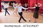 smiling people practicing... | Shutterstock . vector #673119637