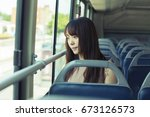 the girl sitting in the bus | Shutterstock . vector #673126573