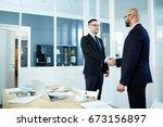 handshaking men in suits... | Shutterstock . vector #673156897