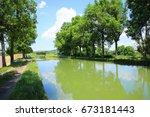the idyllic canal de bourgogne... | Shutterstock . vector #673181443