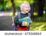 cute little schoolboy outdoors...   Shutterstock . vector #673268863