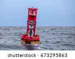 a close up photo of a red buoy... | Shutterstock . vector #673295863