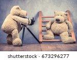 teddy bear toy photographer...   Shutterstock . vector #673296277