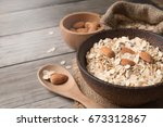 dry rolled oat flakes oatmeal... | Shutterstock . vector #673312867