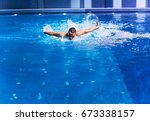 male swimmer at the swimming... | Shutterstock . vector #673338157