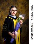 chinese girl in graduation... | Shutterstock . vector #673377007