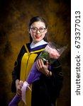 chinese girl in graduation... | Shutterstock . vector #673377013