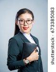 chinese business girl  | Shutterstock . vector #673385083