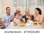 big family drinking tea in... | Shutterstock . vector #673426183