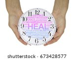 Small photo of There is always time for Healing - female hands holding a clock face containing a pink and blue graduated HEAL word cloud isolated on a white background