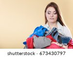 young woman carrying stack pile ... | Shutterstock . vector #673430797