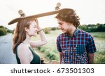 skateboarding couple having fun ... | Shutterstock . vector #673501303