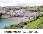 port isaac  cornwall  uk. july... | Shutterstock . vector #673504987