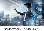 experiencing virtual reality.... | Shutterstock . vector #673531573