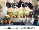 saucepans hanging over sink... | Shutterstock . vector #673534633