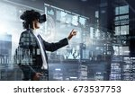 experiencing virtual reality.... | Shutterstock . vector #673537753