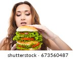 happy young woman eating big... | Shutterstock . vector #673560487