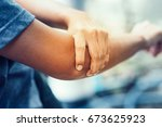 elbow bone fracture. female... | Shutterstock . vector #673625923