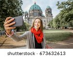 young woman tourist making... | Shutterstock . vector #673632613