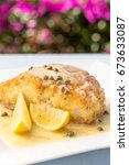 Small photo of Fresh Ono, or Wahoo, sauteed in a macadamia nut crust with capers and lemon sauce