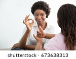 smiling young mother learning... | Shutterstock . vector #673638313