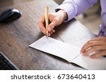 close up of a businessperson's... | Shutterstock . vector #673640413