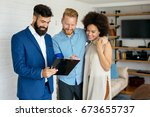 real estate agent with couple... | Shutterstock . vector #673655737