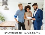 family with real estate agent... | Shutterstock . vector #673655743