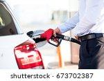 Man Fills A Car With Petrol