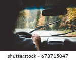man driving car in rain weather.... | Shutterstock . vector #673715047