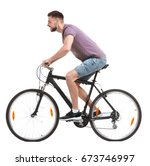 handsome young man riding... | Shutterstock . vector #673746997