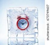 red alarm clock in a piece of... | Shutterstock . vector #673749607