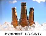 Small photo of brown bottles beer chill in ice